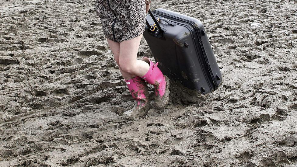 Suitcase in mud